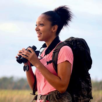 Corina Newsome holding binoculars