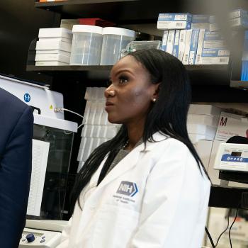 Dr. Corbett in a white lab coat