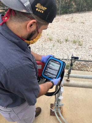 Spoetzl worker with monitoring equipment