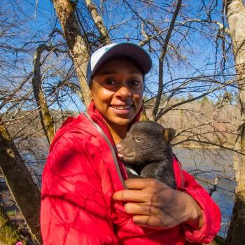 Dr. Wynn-Grant holding a bear cub