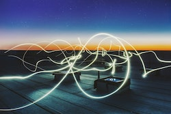 lines of light connecting rooftop structures