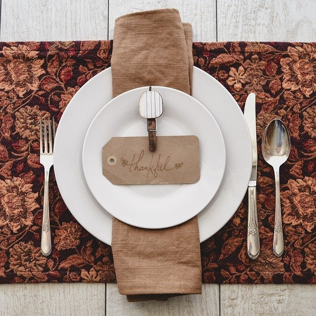 Thanksgiving place set with dishes and napkin