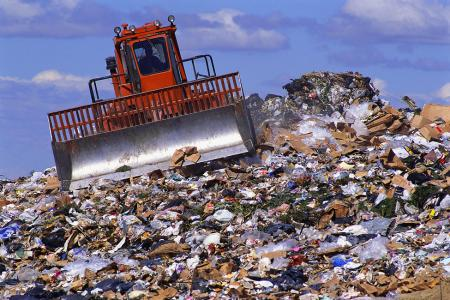 Landfill pile of trash with bulldozer
