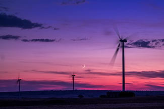 wind farm wind mills at evening