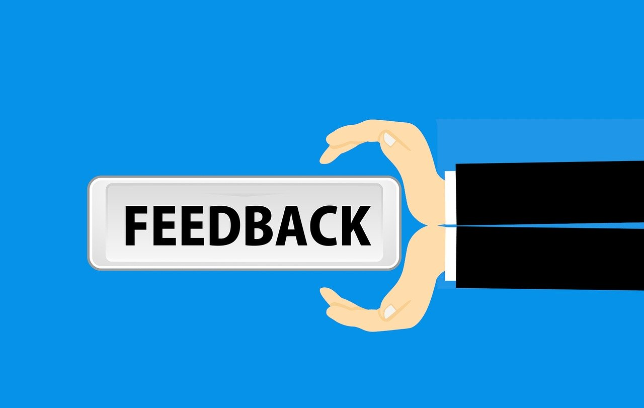Feedback button with floating hands graphic