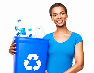 woman holding blue recycle bin full of water bottles
