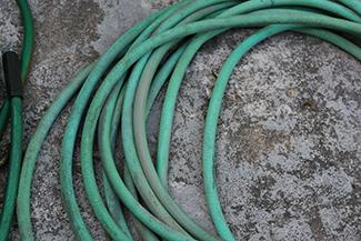 coiled green garden water hose
