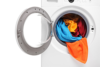 Clothes washer open full of clothes
