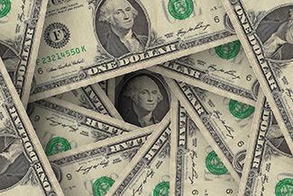 swirled pile of cash money bills