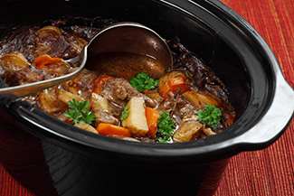 slow cooker with meat and vegetables