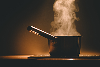 Hot stove with steaming pot