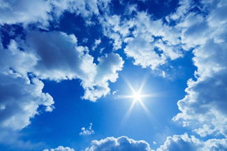 bright blue cloud spotted view of sun