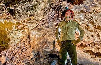 man looking up in Colorado Bend cave
