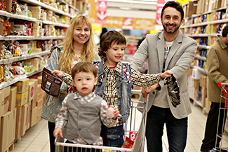 family around grocery cart shopping