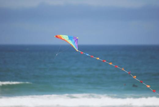 kite flying over beach