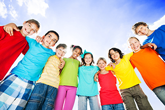 Group of children posed in semi-circle