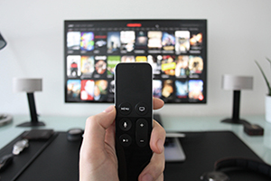 Smart TV remote pointed at screen